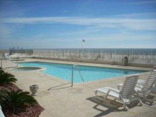 Orange Beach condo photo - Pool area with full sized pool, kiddie pool and newly refurbished hot tub!!