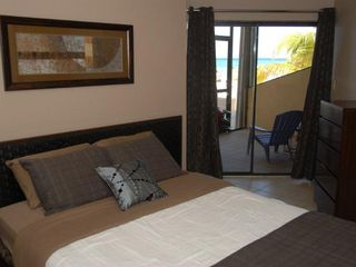 Grand Cayman condo photo - Bedroom with access to patio