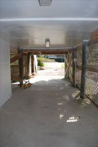 Isle of Palms house rental - Carport under home- outdoor shower; well lit; great area for kids to play