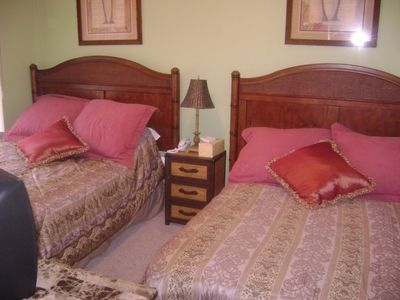 Guest Bedroom-Two Double Beds with Television.