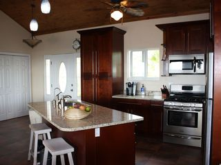 Cayman Brac house photo - Open kitchen w/large island, granite counter tops and stainless steel appliances