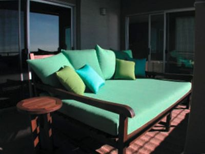 Snooze on our comfy daybed overlooking the ocean on our covered