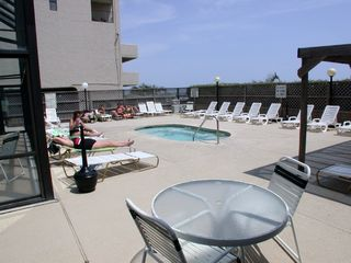 Crescent Beach condo photo - Sun Deck with Hot Tub, Pool building on left