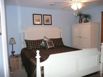 "Master bedroom with king bed, with 32"" flat screen TV and balcony."