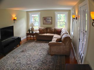 Lake Bomoseen estate photo - The large main living room w/ 1080p HDTV, Bluray, & 2 queen size pull out beds.
