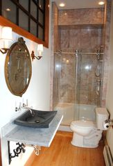 Newport house photo - Pelham Bath: Light filled,10' high, marble tiled, two person sitting shower area