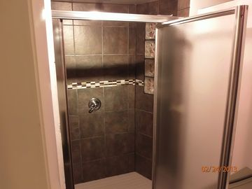 Extra large standup shower with overhead nozzle