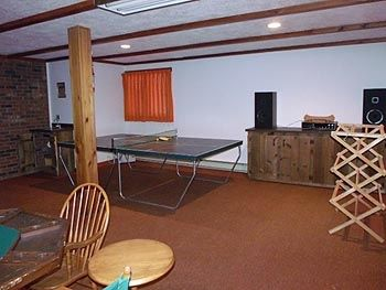 Game room - Ping pong table, stereo, large drying rack for ski pants, etc