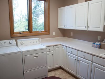 One of two large onsite laundry rooms (main floor and basement).