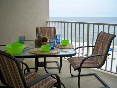 Balcony With Table and Chairs and a Beautiful View