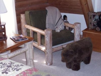 Cozy up in the big Log Chair, feet on the Bear Ottoman and relax in the pines!