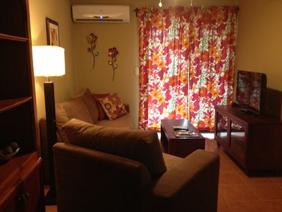 Playa del Coco condo rental - Living room with full size pullout sofa, tv with cable and wifi