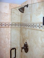 Palmetto Dunes condo photo - Master suite walk-in shower and marble surround. The shower has a tiled bench.