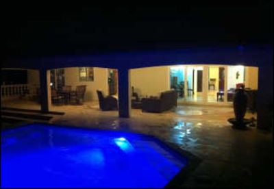 Enjoy the multi-colored pool and patio - night and day.