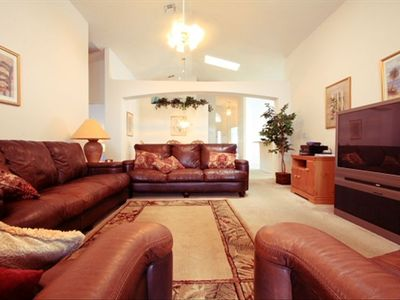 Huge, Large Screen TV and Leather Living Room Suite are Luxurious