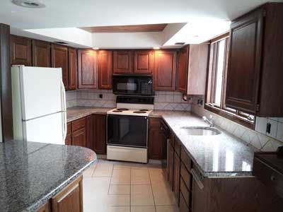 All new granite countertops and tile in kitchen