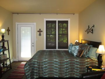 Eureka Springs condo rental - View of bedroom. Read the reviews on the bed. Everyone loves it.