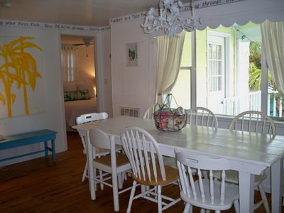 Plenty of room at the large kitchen table with a view of the front porch.