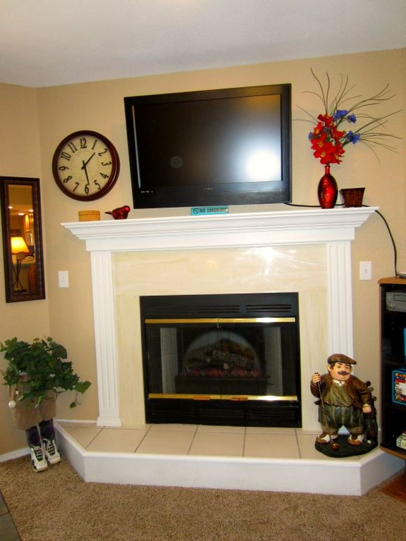 The fireplace is electric and easy to turn on by flipping the switch.