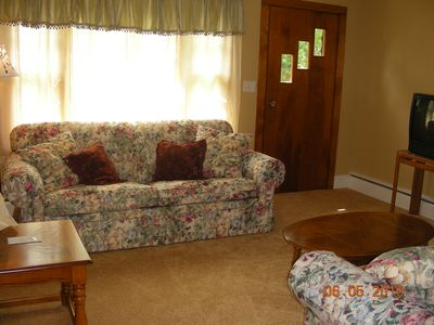 Lake George house rental - The charming living room with 2 couches. One is a pull-out couch.