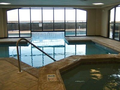 Indoor-outdoor pool and hot tub for condo guest.