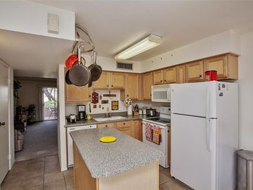 Mesa townhome rental - This quaint kitchen comes fully equipped with everything you need