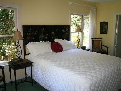 Master suite has windows that surround you with views of the garden.