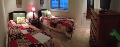 Panoramic photo Bedroom w/ twin beds, flat screen TV, & ceiling fan w/ remote