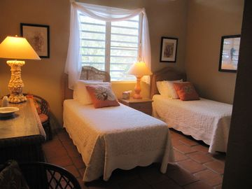 Upstairs guestroom with private bath. Can be converted into one king bed.