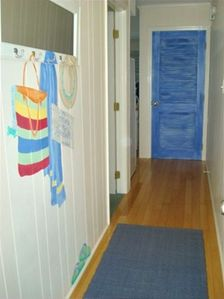 entrance -stackable washer & dryer is behind the blue door