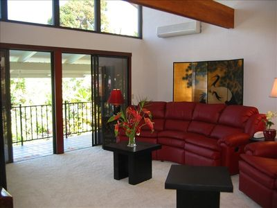 Upper living room with custom leather sofas