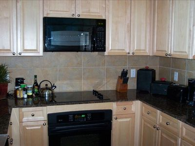 Brand new unit...granite countertops, tile floors, s/s outdoor grill