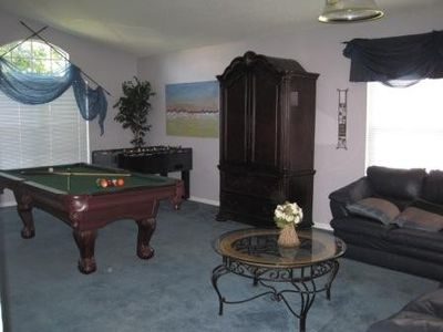7 foot pool & foosball table + relax area in Den