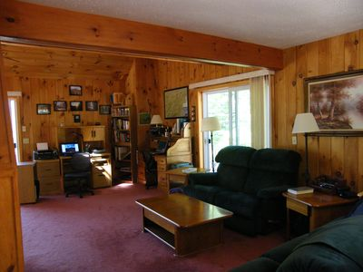 Living room with lots of room for multimedia pursuits, wi-fi, HD TV, DVD.