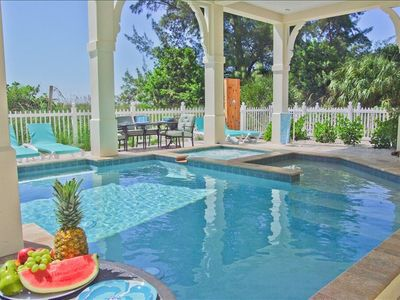 gorgeous pool area with spa, outdoor kitchen, bar, outdoor shower