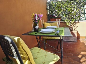 Sunny terrace is the perfect spot for dining or just enjoying the sunshine