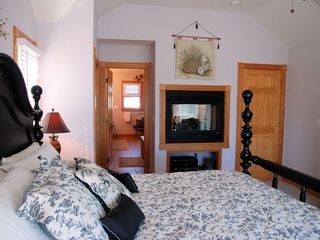 Corolla house photo - Master bedroom into huge Master Bath with fireplace and whirlpool tub
