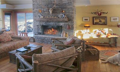 main living area with eight foot stone fireplace...