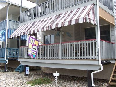 Boardwalk house rental - Covered porch extends this home's living space with room for dining & relaxing!