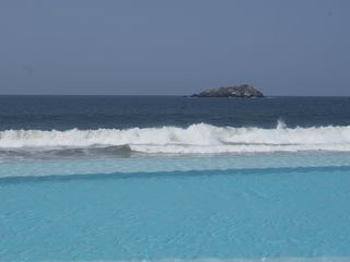 Ixtapa condo photo - view from inside the pool. almost merges with the sea.