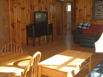 Living room/dining room, 1950's hardwood flooring and real 'Knotty Pine' walls