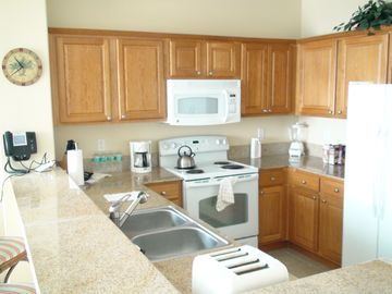 Kitchen with full appliances, granite, and everything you could possibly need!