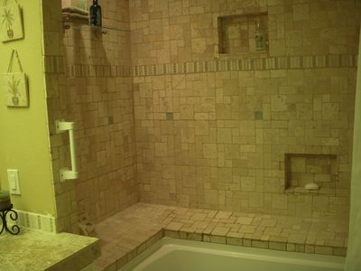 Stone tiled tub/shower in Guest Bathroom