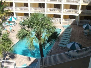 Pelican Pointe Court Yard and Pool. Steps to the beach!