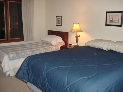 One of the bedrooms upstairs has a double bed and a twin bed, across from bath