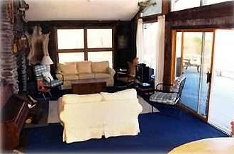 Living room with access to large rap-around deck