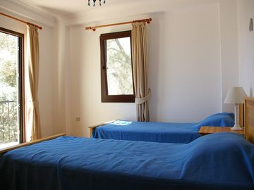 Twin bedroom with balcony and sea views