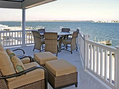 6 bed 6 bath, with elevator and boat dock. Beautiful bay view from the 3rd floor deck with new outdoor furniture