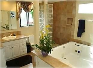 Master Bath with 2 person Jacuzzi, glass block shower and piped in music