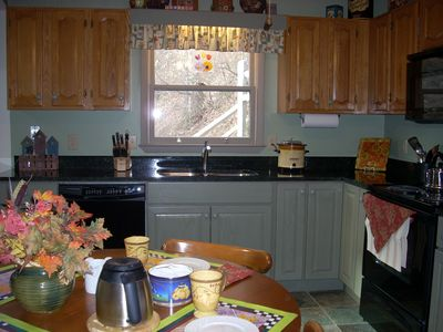 The updated country kitchen makes cooking and eating-in a pleasure.
